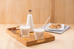 Dairy products. A bottle of milk and glass of milk serve with al Royalty Free Stock Image