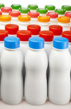 Dairy products bottles with bright covers Royalty Free Stock Photography