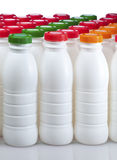 Dairy products bottles with bright covers Royalty Free Stock Image
