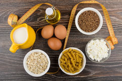 Dairy products, chicken eggs, pasta, cereals and vegetable oil. Dairy products, chicken eggs, pasta from durum wheat, oatmeal, buckwheat and vegetable oil in Royalty Free Stock Photography