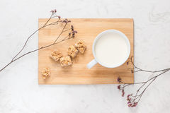 Dairy products. A cup of milk serve with almond candies on a rus Stock Photos