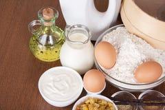 Dairy products, eggs, flour, sunflower oil, raisin Stock Photo