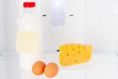 Dairy products and eggs on the shelf of the refrigerator Royalty Free Stock Photo