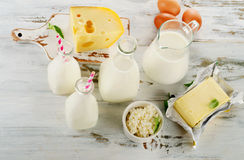 Dairy products and eggs on a white wooden table. Royalty Free Stock Photos