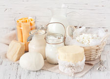 Dairy products. Fresh dairy products on an old kitchen board. Rustic style Royalty Free Stock Image