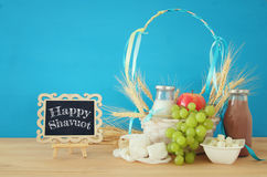 Dairy products and fruits. Symbols of jewish holiday - Shavuot Stock Image