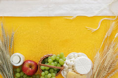 Dairy products and fruits. Symbols of jewish holiday - Shavuot Royalty Free Stock Photography