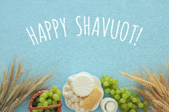 Dairy products and fruits. Symbols of jewish holiday - Shavuot. Top view image of dairy products and fruits on wooden background. Symbols of jewish holiday Stock Image
