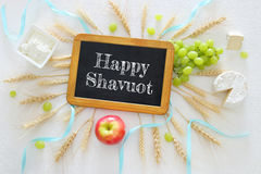 Dairy products and fruits. Symbols of jewish holiday - Shavuot Royalty Free Stock Photo