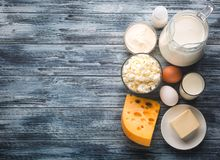 Dairy products grocery assortment on rustic wooden table Royalty Free Stock Photography