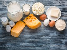 Dairy products grocery assortment on rustic wooden table Royalty Free Stock Photos
