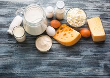 Dairy products grocery assortment on rustic wooden table Royalty Free Stock Photo