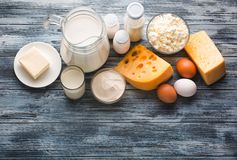 Dairy products grocery assortment on rustic wooden table Stock Image