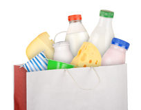 Dairy products. Grocery bag with dairy products isolated on white background Stock Photo