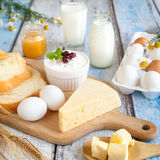 Dairy products, honey and fresh eggs. Dairy products: milk, beaded cottage cheese, butter, yogurt, cheese. With bread, honey and fresh eggs Royalty Free Stock Images