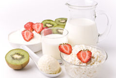Dairy products, kiwi and strawberries Stock Images