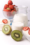 Dairy products, kiwi and strawberries Stock Photos