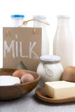 Dairy products labeled milk on a white background Royalty Free Stock Photos