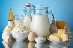 Dairy products, milk, cheese, egg, yogurt. Sour cream, cottage cheese and butter on blue background still life Royalty Free Stock Image