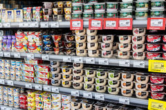 Dairy products on the shelf in the store royalty free stock images