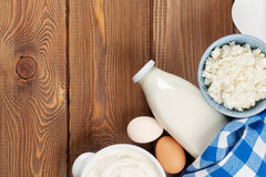 Dairy products. Sour cream, milk, cheese, egg, yogurt and butter. Dairy products on wooden table. Sour cream, milk, cheese, egg, yogurt and butter. Top view with royalty free stock images
