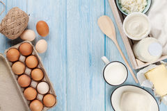 Dairy products. Sour cream, milk, cheese, egg, yogurt and butter. Dairy products on wooden table. Sour cream, milk, cheese, egg, yogurt and butter. Top view with stock image