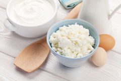 Dairy products. Sour cream, milk and cheese. Dairy products on wooden table. Sour cream, milk and cheese stock images