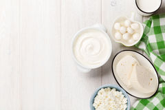 Dairy products. Sour cream, milk, cheese, yogurt and butter. Dairy products on wooden table. Sour cream, milk, cheese, yogurt and butter. Top view with copy royalty free stock photos