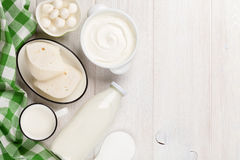 Dairy products. Sour cream, milk, cheese, yogurt and butter. Dairy products on wooden table. Sour cream, milk, cheese, yogurt and butter. Top view with copy stock images