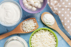 Dairy products. On stone table. Sour cream, milk, cheese, yogurt and curd. Top view Royalty Free Stock Images