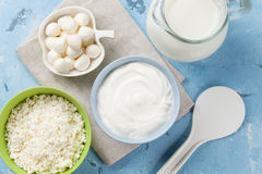 Dairy products. On stone table. Sour cream, milk, cheese, yogurt and curd. Top view Royalty Free Stock Photography
