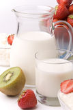 Dairy products. strawberries and kiwi Stock Images