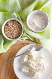 Dairy products and wheat germs. Cottage cheese with wheat and sour cream Stock Images