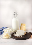 Dairy products on white wooden table. Royalty Free Stock Photo
