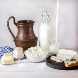Dairy products on white wooden table. Stock Photos