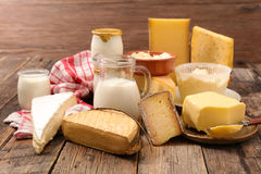 Dairy products. On wood background stock photos