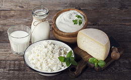 Dairy products on wooden background stock photos