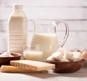 Dairy products on wooden table. Milk and dairy products on wooden table Royalty Free Stock Photo