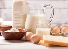 Dairy products on wooden table. Milk and dairy products on wooden table Royalty Free Stock Image