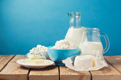 Dairy products on wooden table over blue background Royalty Free Stock Photos