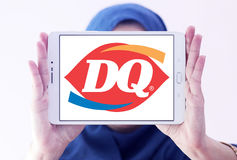 Dairy Queen, DQ fast food restaurant logo. Logo of  Dairy Queen, DQ fast food restaurant on samsung tablet  holded by arab muslim woman Stock Image