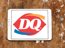 Dairy Queen, DQ fast food restaurant logo. Logo of  Dairy Queen, DQ fast food restaurant  on samsung tablet on wooden background Stock Images