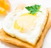 heart shaped fried egg for breakfast stock images
