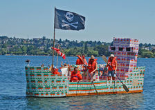 The dairygold ship in the milk carton races. Seattle Seafair milk carton derby boat races, Seattle, Washington, people make water craft, using milk cartons for Royalty Free Stock Photos