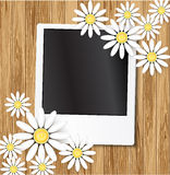 Dais and photo frame on wood background Stock Image