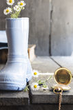 Daisies in a boot and pocket watch, background for card Stock Photography