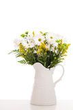 Daisies in a pitcher Royalty Free Stock Images