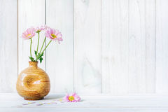 Daisies in vase on a old wooden table Royalty Free Stock Photography