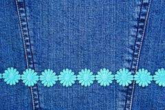 Daisy chain on denim Stock Photos