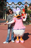 Daisy Duck And Tourist In Disney World Royalty Free Stock Images